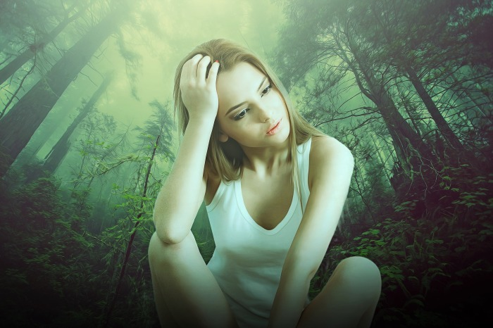woman-thinking-in-forest
