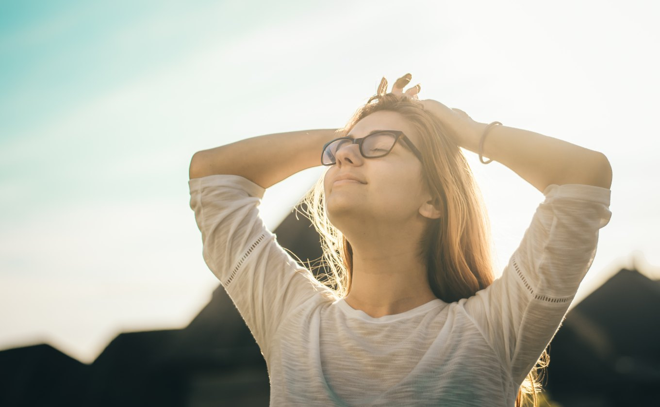 woman-happy-and-smiling-hands-above-head-unsplash